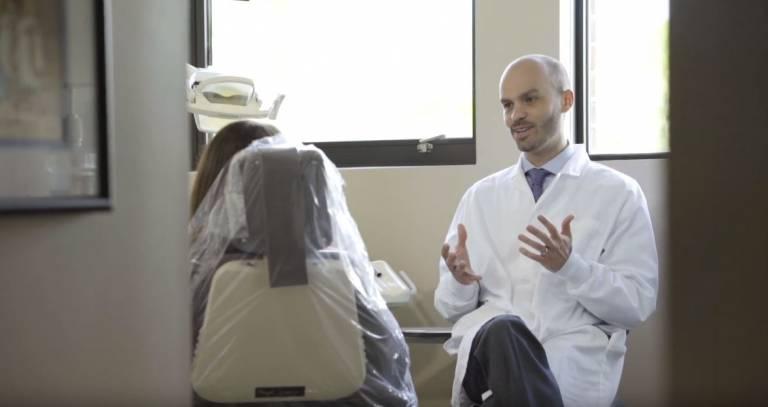Dr. Gens explaining procedure to a patient